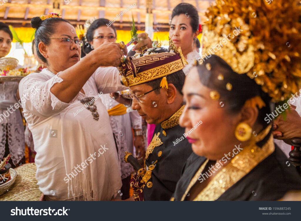 stock photo the king and queen havin their hair cut during coronation ritual ceremony of the king and queen of 1596887245